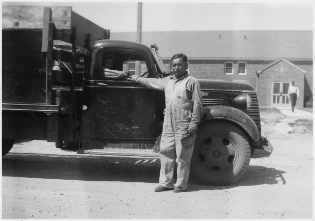 Truck_driver_David_Tiokasin_and_his_truck_-_NARA_-_285888